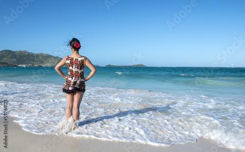 Woman in Short Sun Dress Standing on a Caribbean Beach