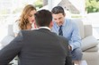 Couple in meeting with a financial adviser at home