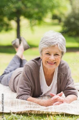 Portrait of a smiling senior woman at park