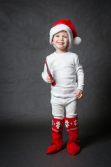 Cute little Santa with red star, gray background