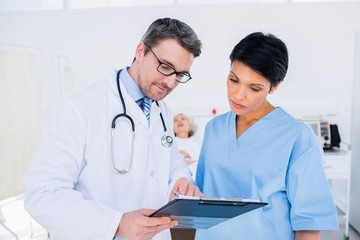Doctors discussing medical reports