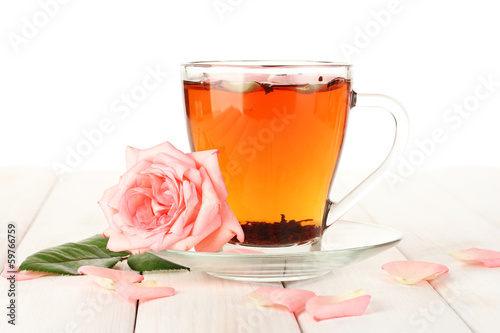 cup of tea with roses on white wooden table