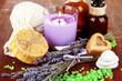 Still life with lavender candle, soap, massage balls, bottles,