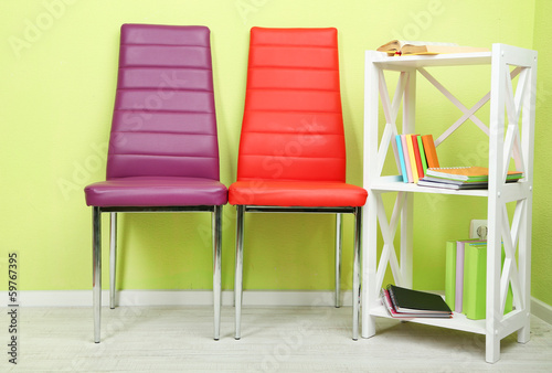 Beautiful interior with modern  color chairs,  books