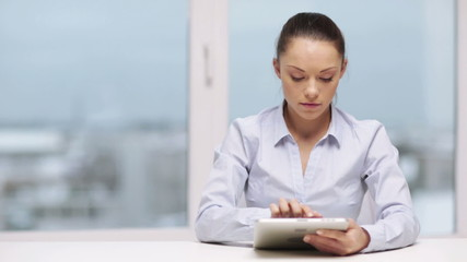 serious businesswoman with tablet pc
