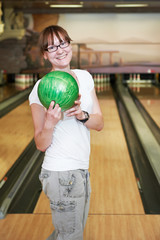 smiling female bowling player