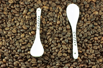 Coffee beans with a spoon