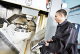 worker operating metal machining center