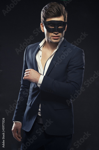 Handsome man in mask Poster
