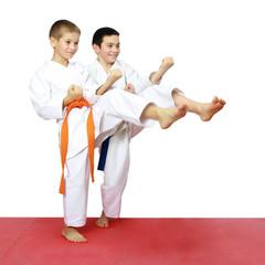 Boys athletes train beat kicks leg