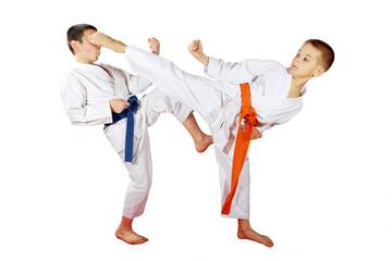 Athletes train paired exercises on a white background