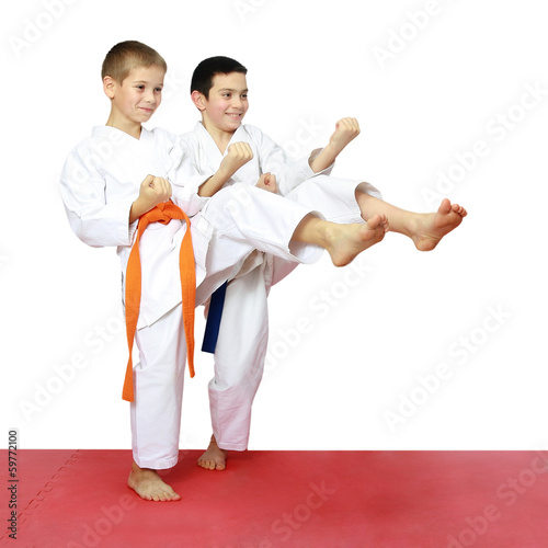 Boys athletes train beat kicks leg