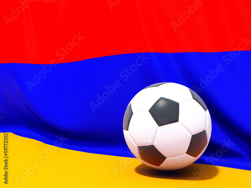 Flag of armenia with football in front of it