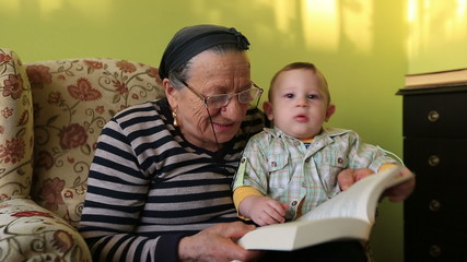 grandmother reading a book to grandson