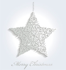 Christmas ornament star on light background.