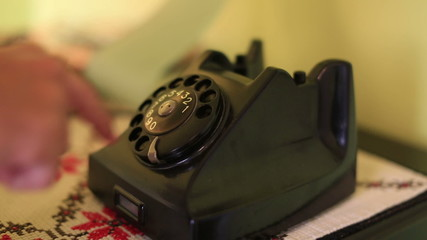 using retro phone, calling rotary telephone