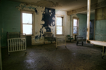 Delapidated Hospital Building With Empty Rusted Beds