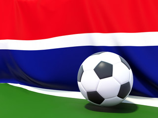 Flag of gambia with football in front of it