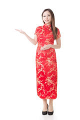 Chinese woman dress traditional cheongsam and introduce