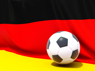 Flag of germany with football in front of it