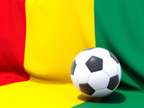 Flag of guinea with football in front of it