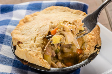 Baked turkey pot pie opened with fork