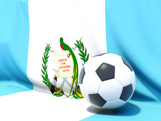 Flag of guatemala with football in front of it