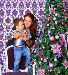 mother and her son near Christmas tree