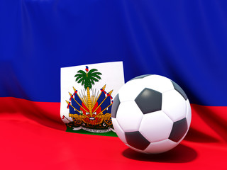 Flag of haiti with football in front of it