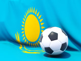 Flag of kazakhstan with football in front of it
