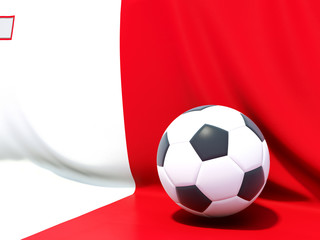 Flag of malta with football in front of it