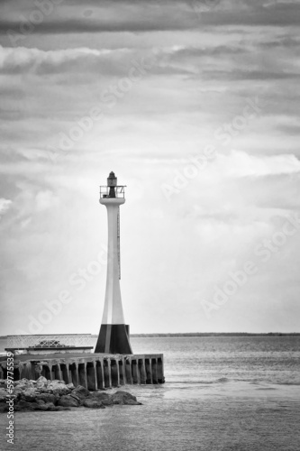 Beautiful lighthouse by the ocean at sunset  - black & white