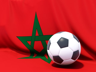 Flag of morocco with football in front of it