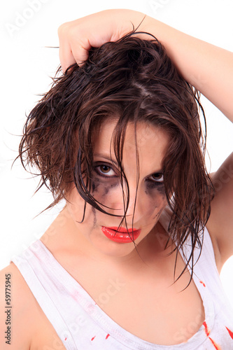 crying young woman with flowed mascara