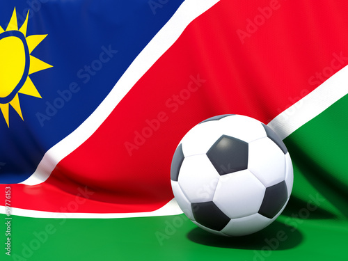 Flag of namibia with football in front of it