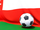 Flag of oman with football in front of it
