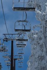 Ski chair lift with skiers. Ski resort in , navacerrada,spain