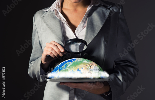 business woman looking at the planet