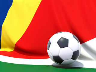 Flag of seychelles with football in front of it