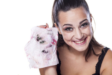 nice beautiful girl shows wet wipes by which removes her makeup