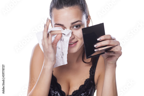 nice beautiful girl removes her make-up using wet wipes