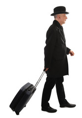 Man with hard plastic suitcase on wheels