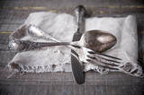 Retro silverware on gray napkin.
