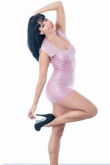 Young Woman Posing in a Short Pink Mini Dress