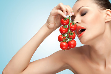 Woman with tomatoes.