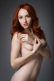 Portrait of a naked girl with red-haired