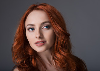 Portrait of young girl with red-haired