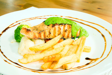 salmon steak with pesto sauce