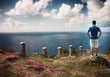 Man standing on top of cliff at Antigua, Caribbean