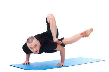 Flexible middle-aged yogi posing looking at camera